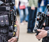 Police officers with machine gun
